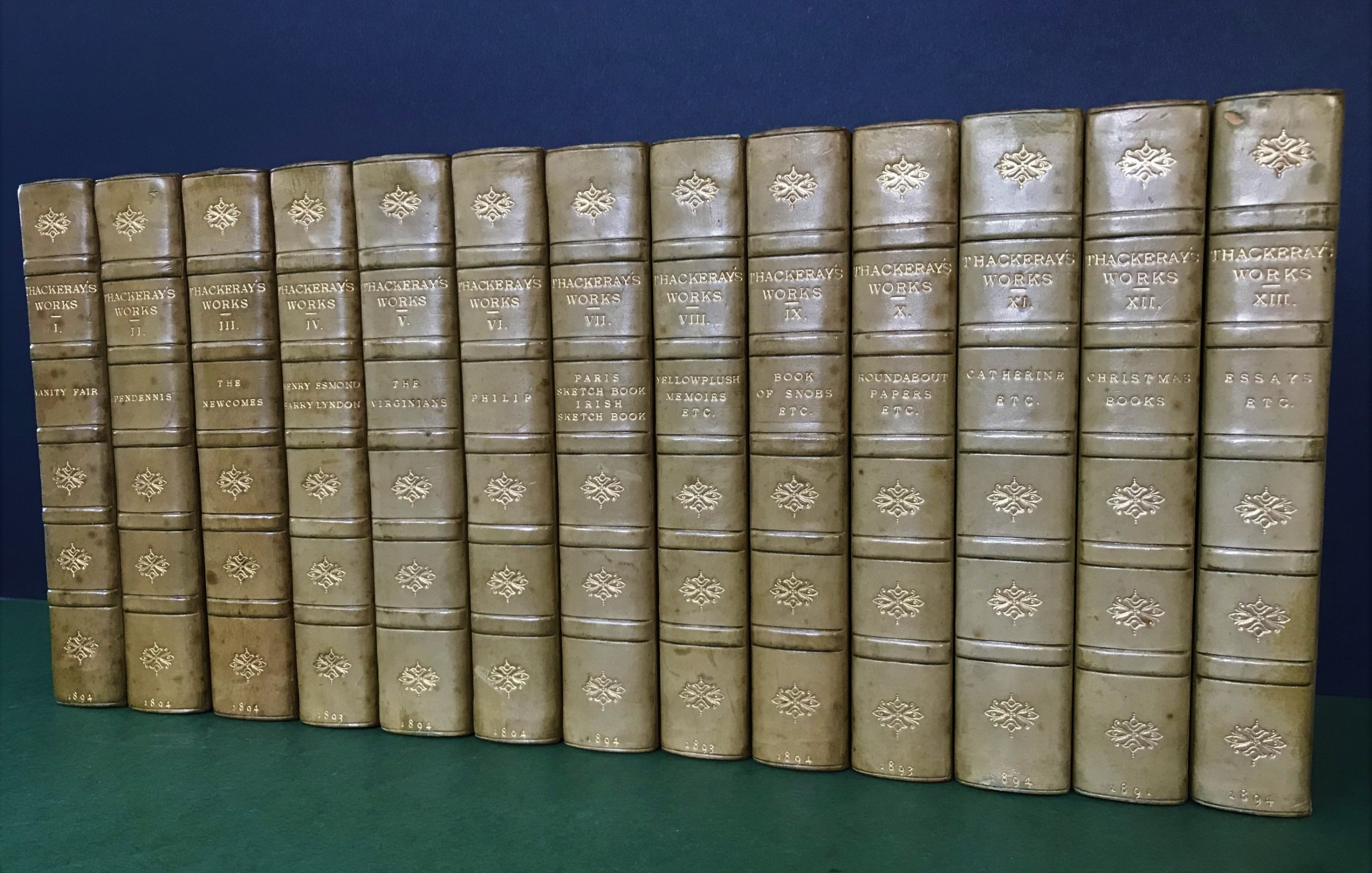 a handsome set of antiquarian books comprising thackeray's works