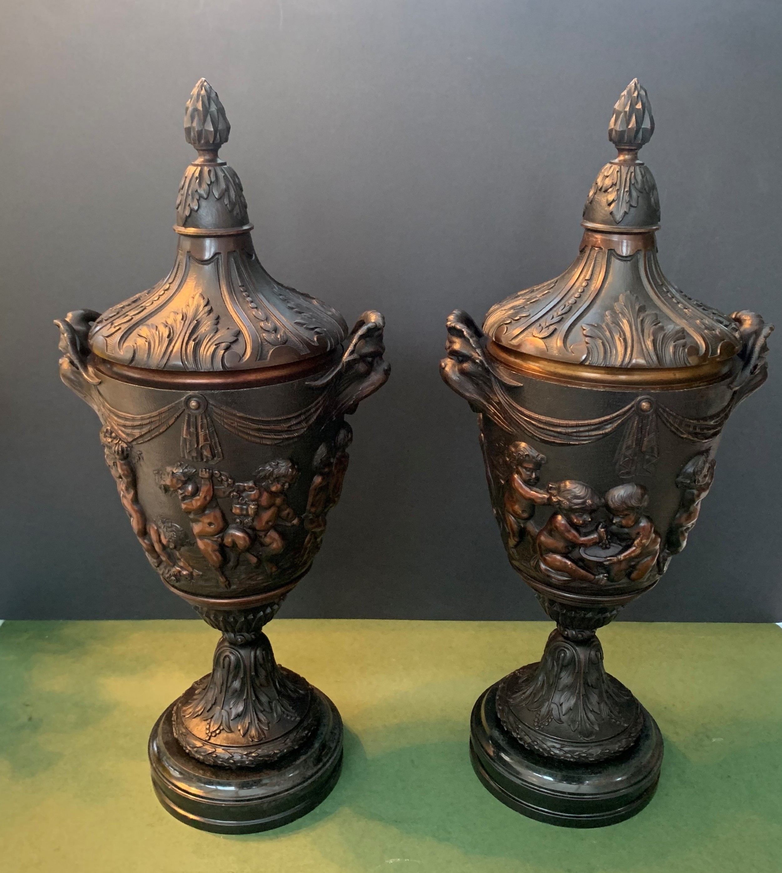 pair of finely cast late 19th century french lidded urns after clodion