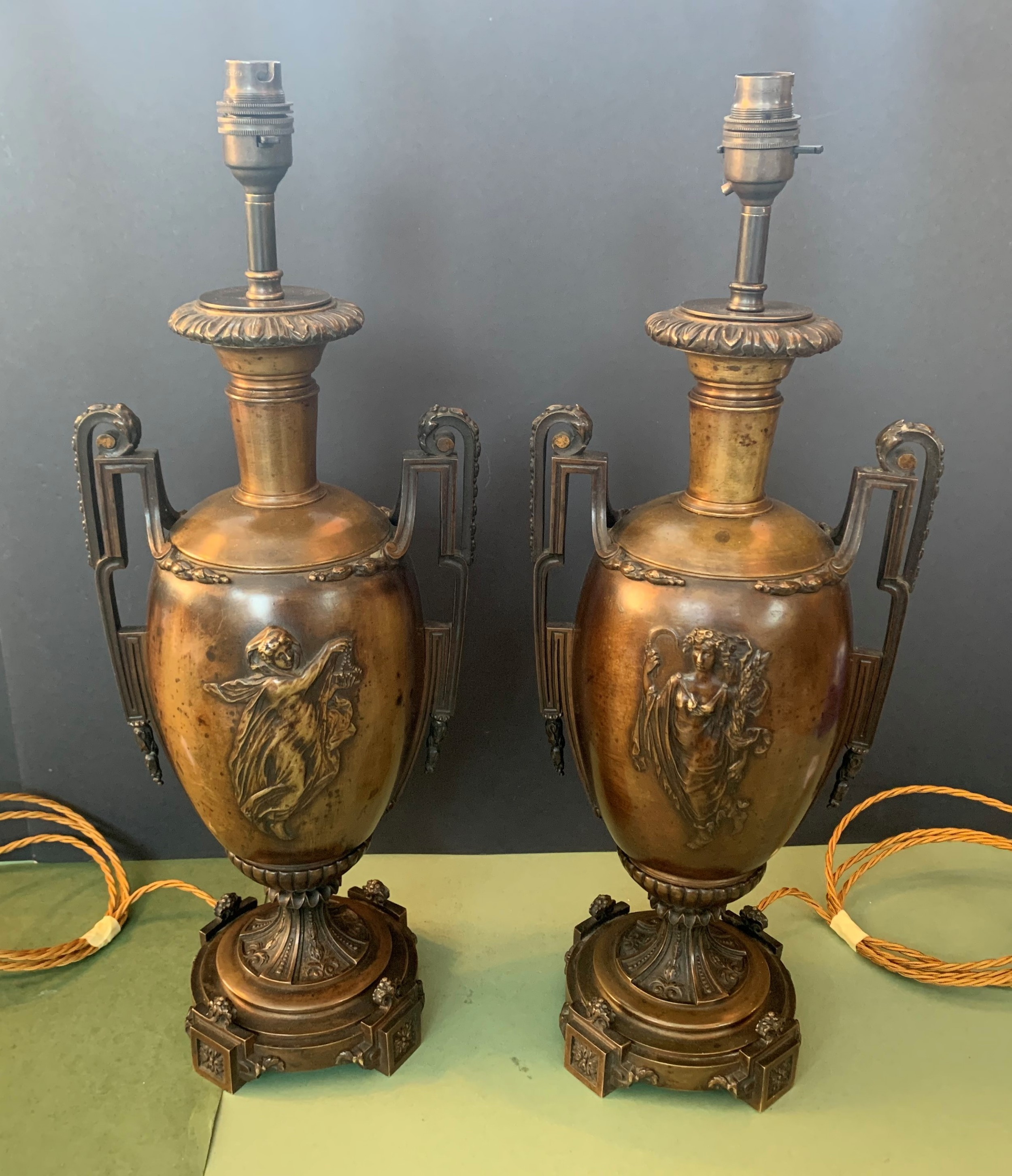 pair of french classically inspired antique bronze lamps