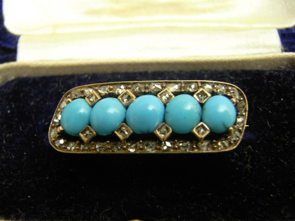 diamond and turquoise set brooch