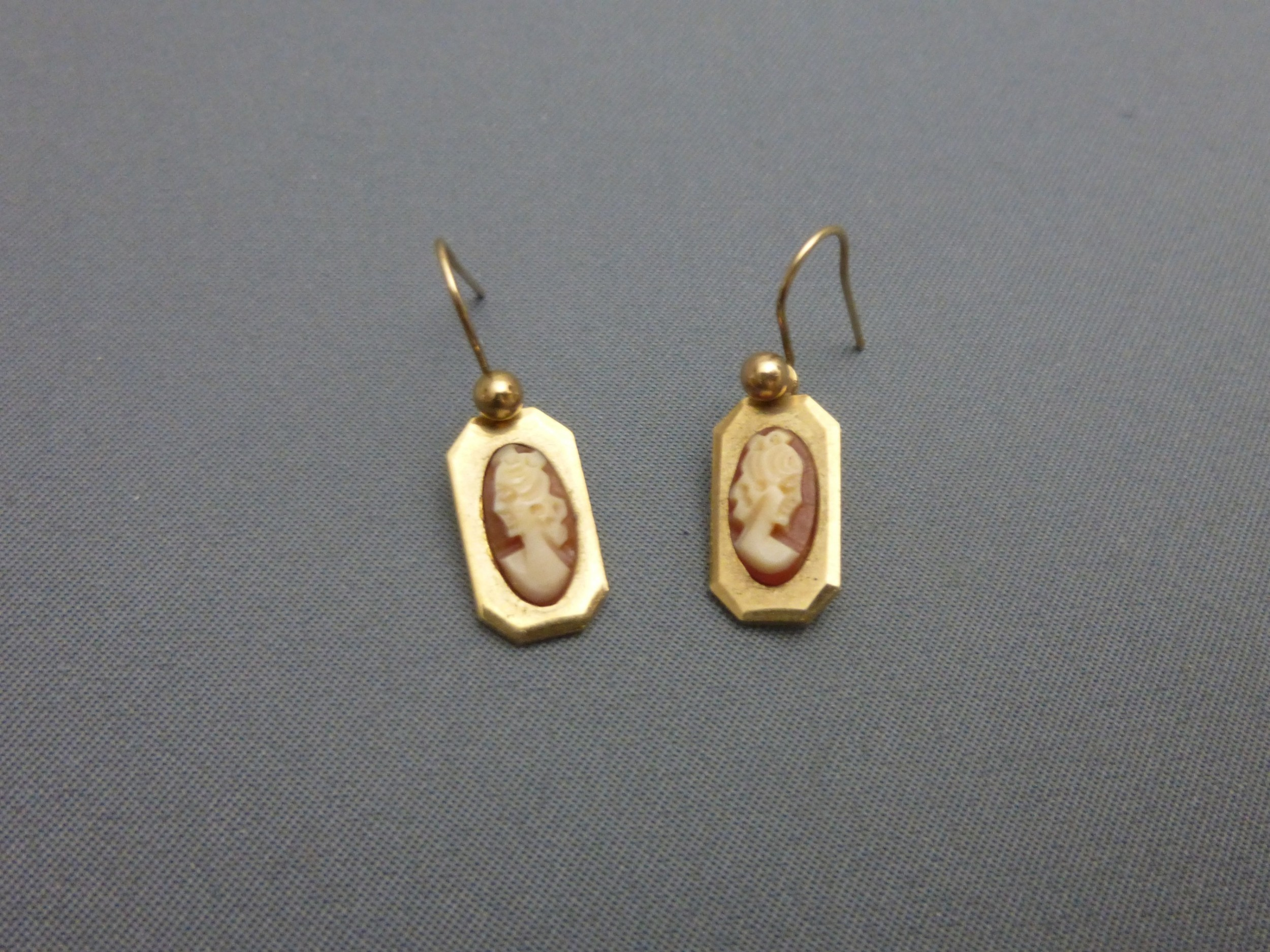 a pair of 9ct gold and cameo earrings
