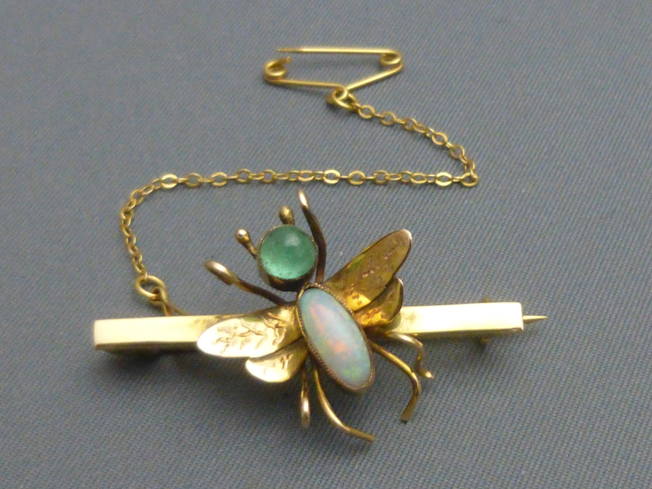 edwardian 9ct gold opal and emerald fly brooch