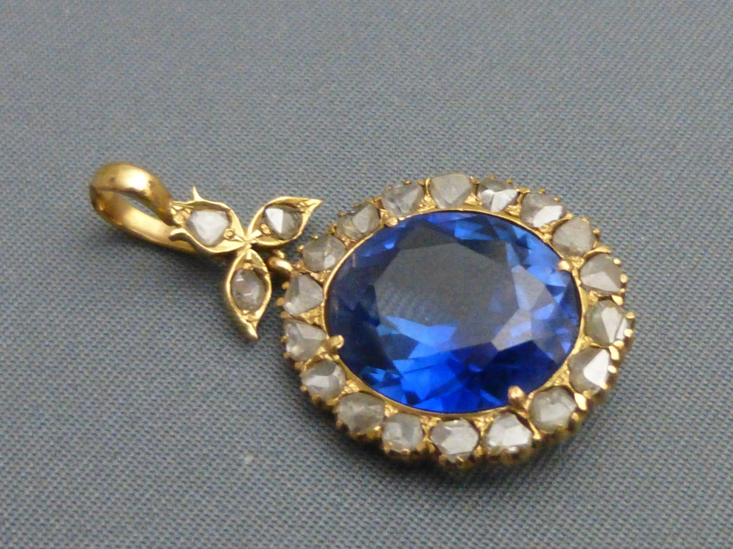 an 18ct gold diamond and synthetic sapphire pendant