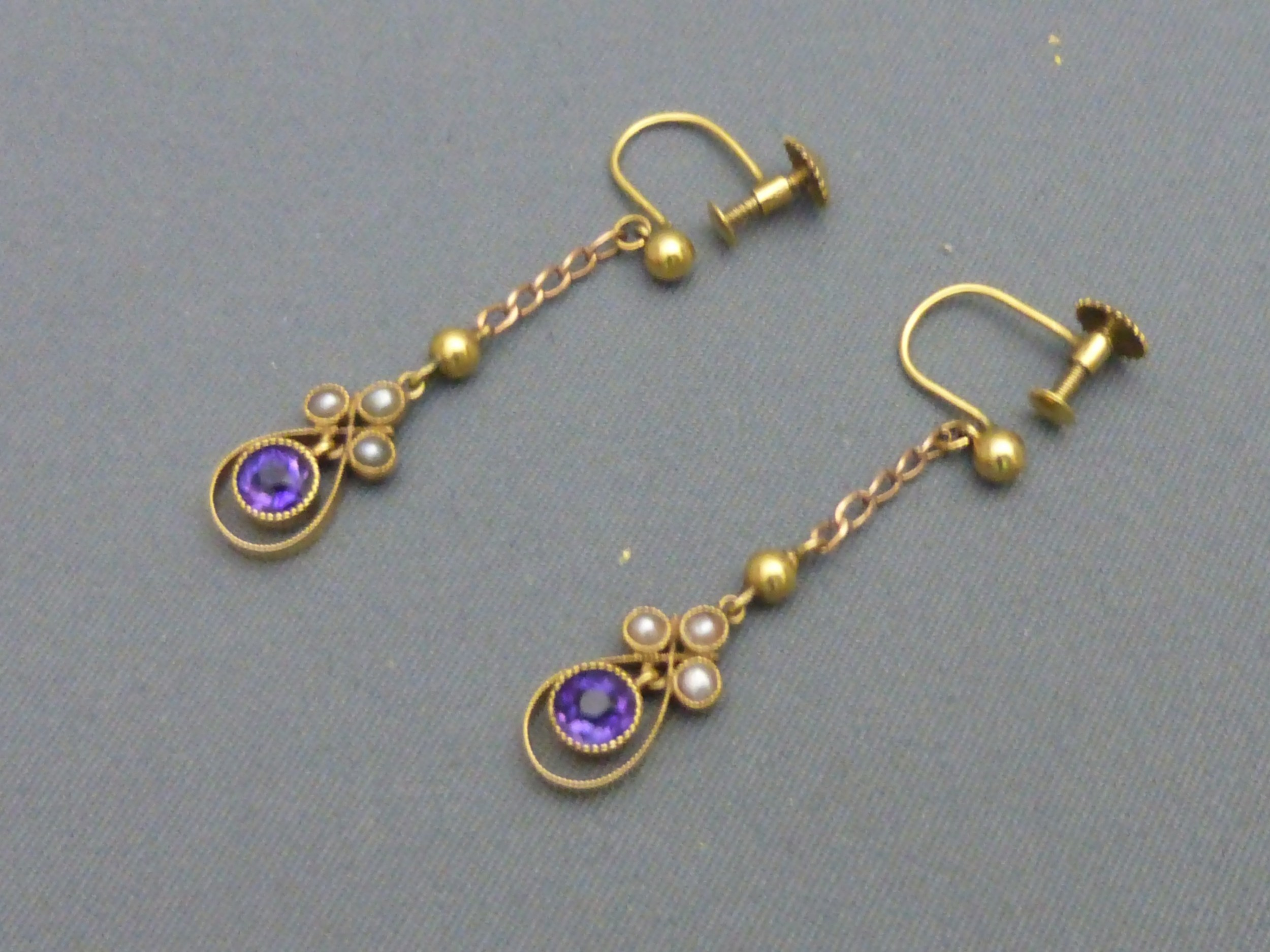 a pair of edwardian 9ct goldamethyst and seed pearl screw earrings