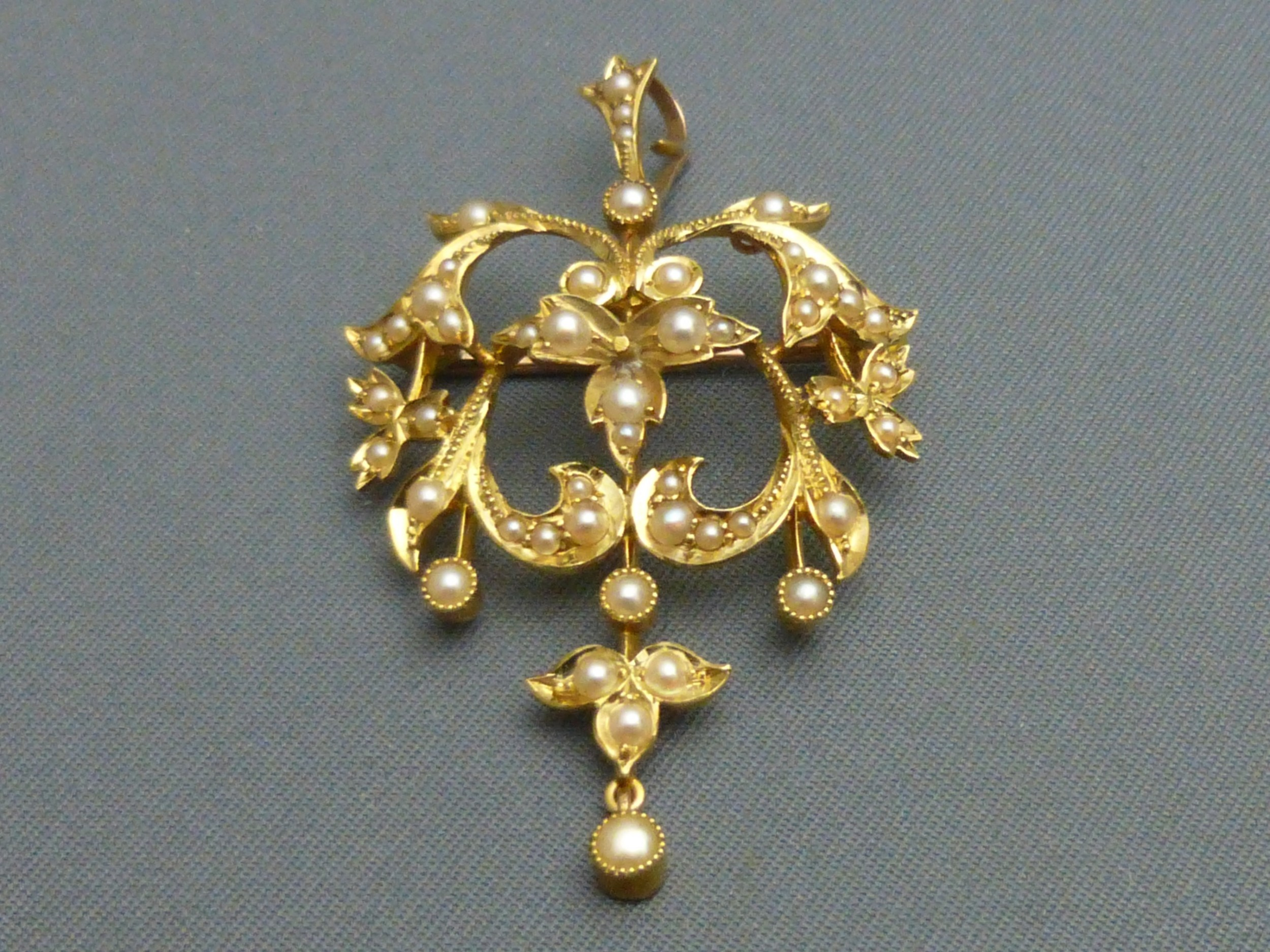 edwardian 15ct gold and pearl pendantbrooch
