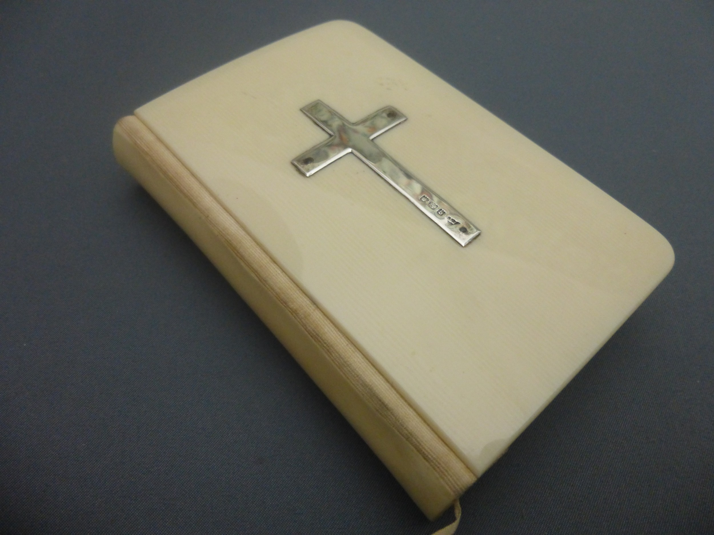 ivorine bound book of common prayer set with a silver cross
