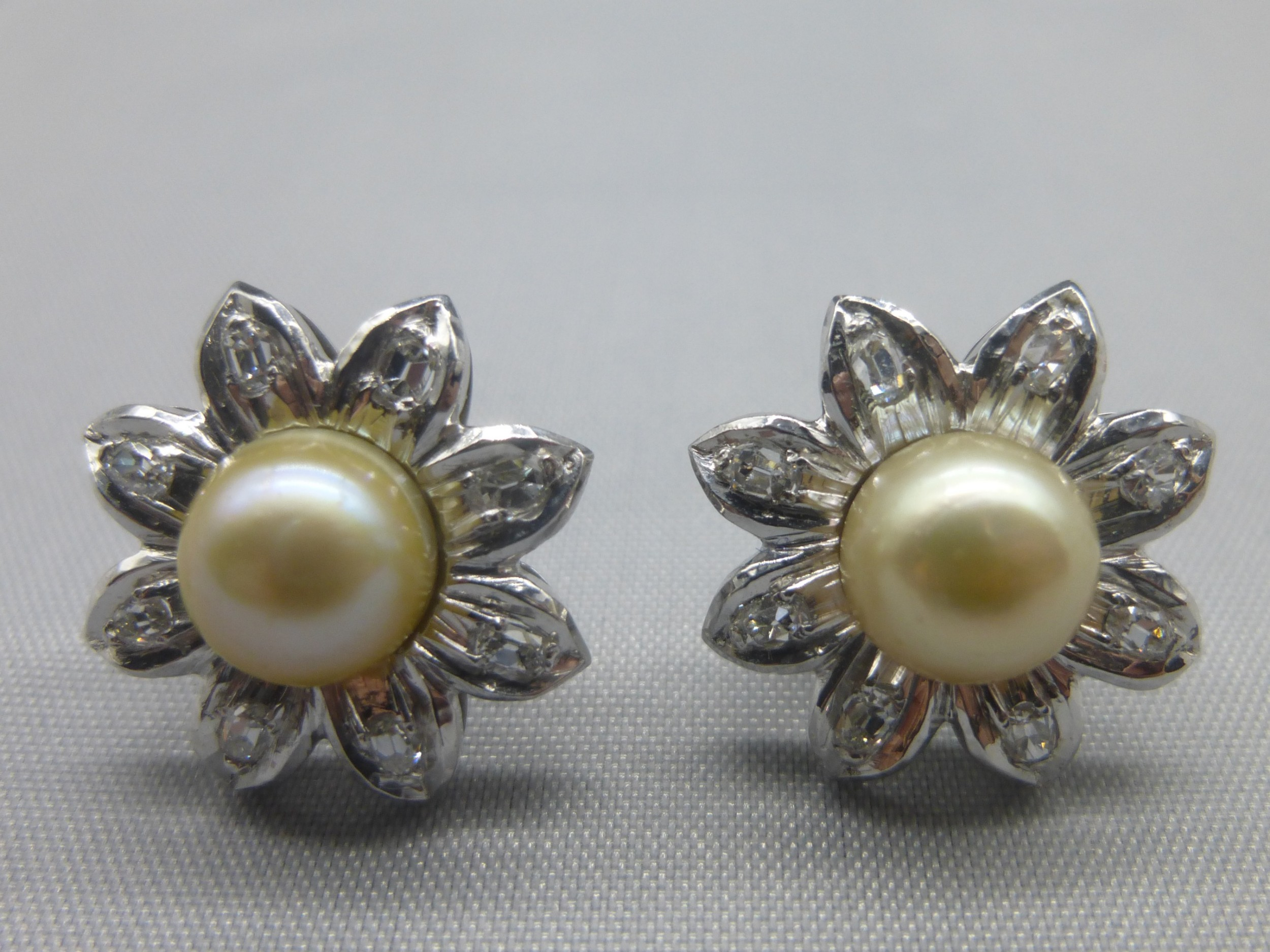 a pair of 18ct white gold diamond and cultured pearl earrings