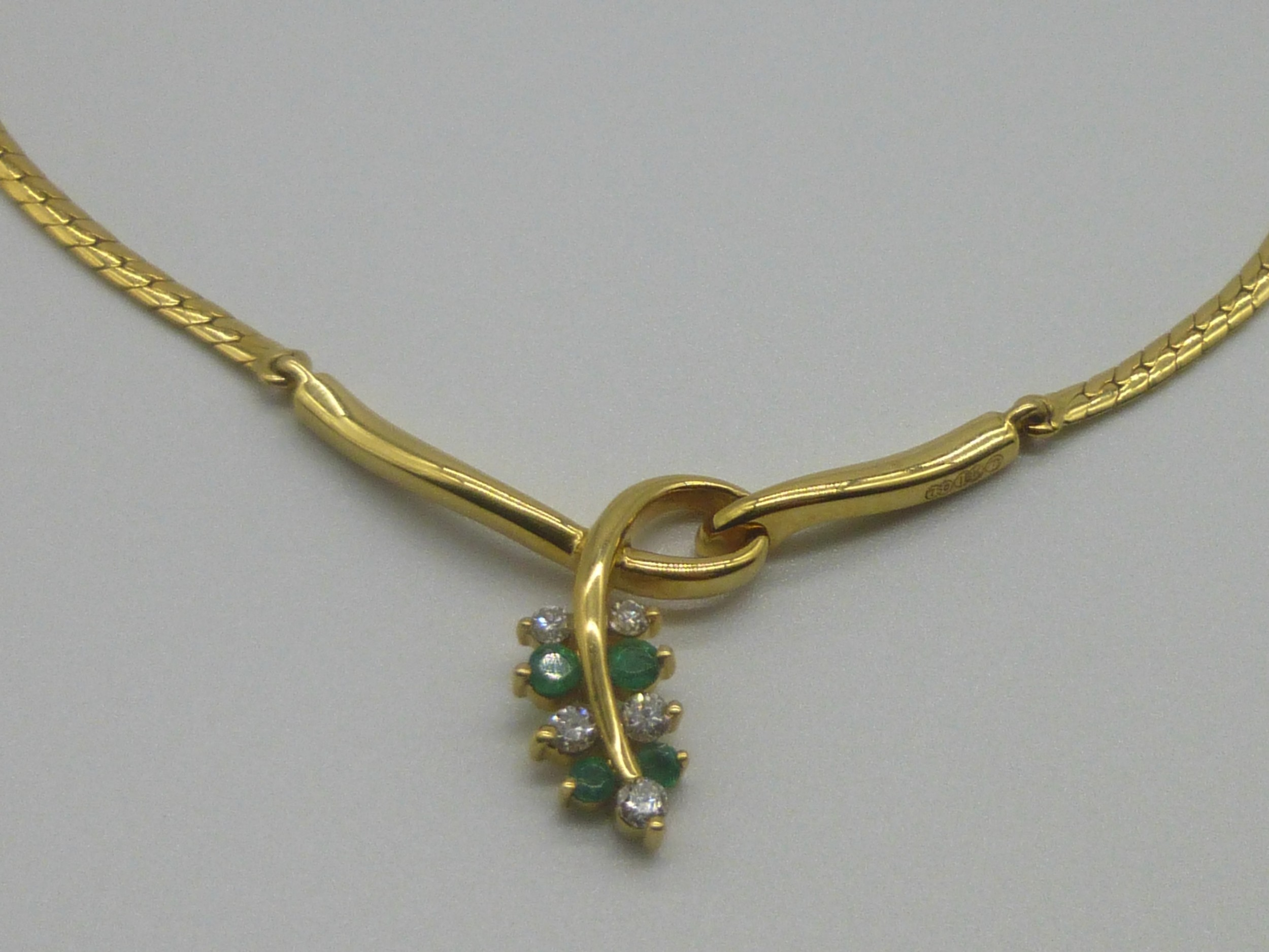 18ct gold emerald and diamond necklace