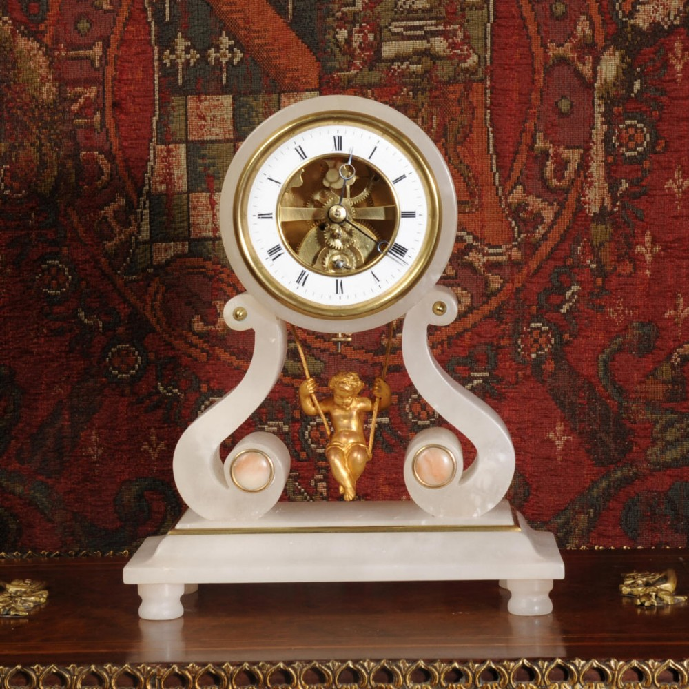 Swinging cherub clock uk