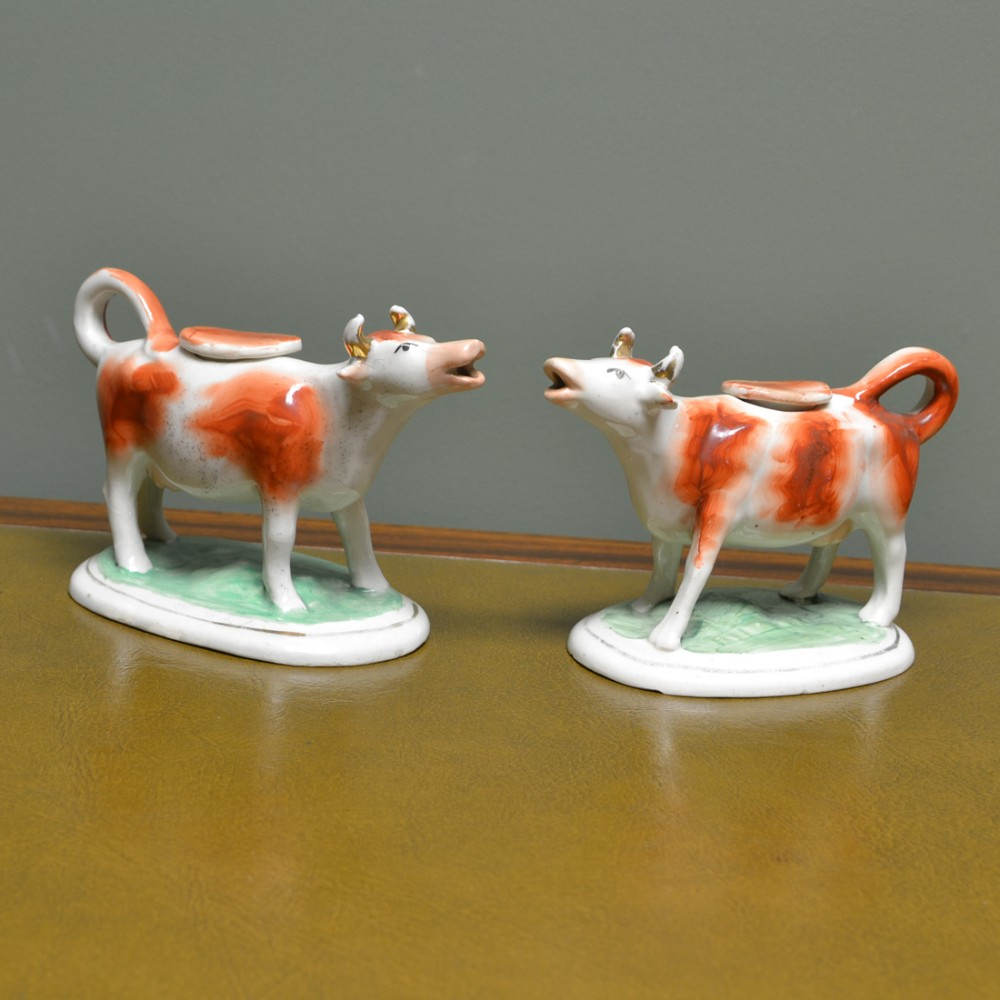 near pair victorian staffordshire pottery cow creamers with lids