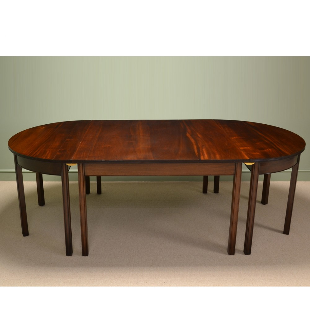the large waring and gillows figured mahogany antique dining table has