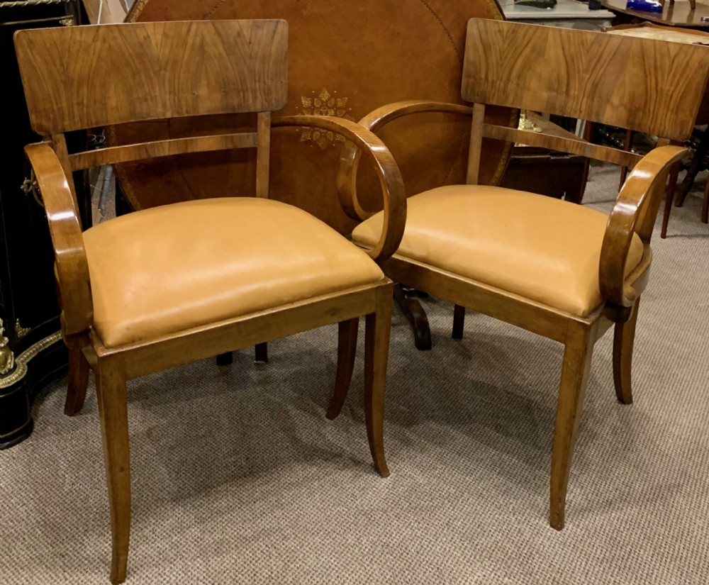 pair of handsome walnut bridge chairs with leather seats c1920's