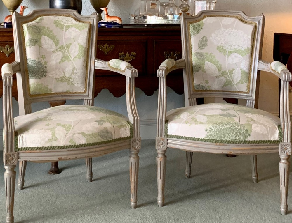 pair of french painted open arm chairs reupholstered in quality fabric c1920's
