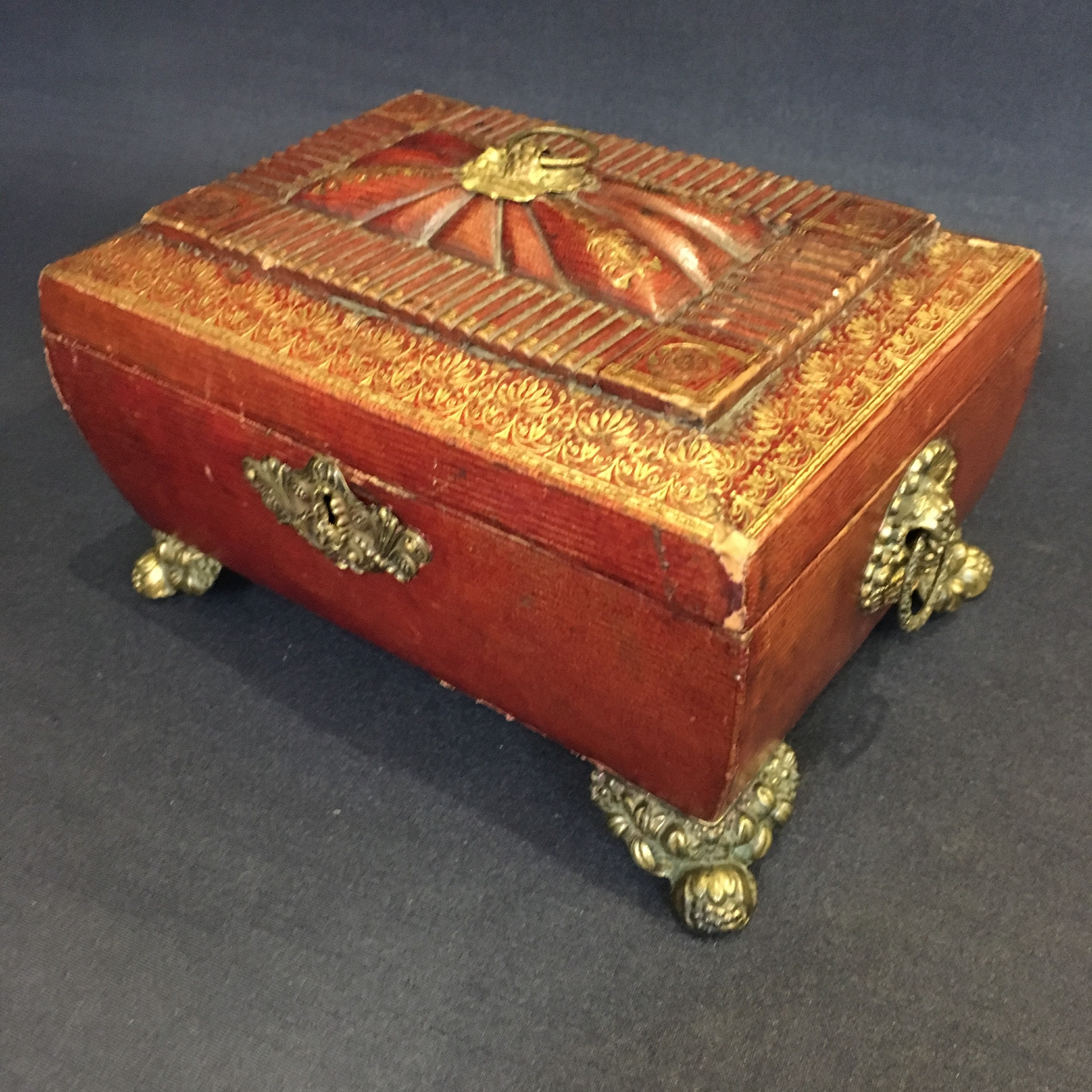 regency leather sewing box with tooled leather work resting on bun feet