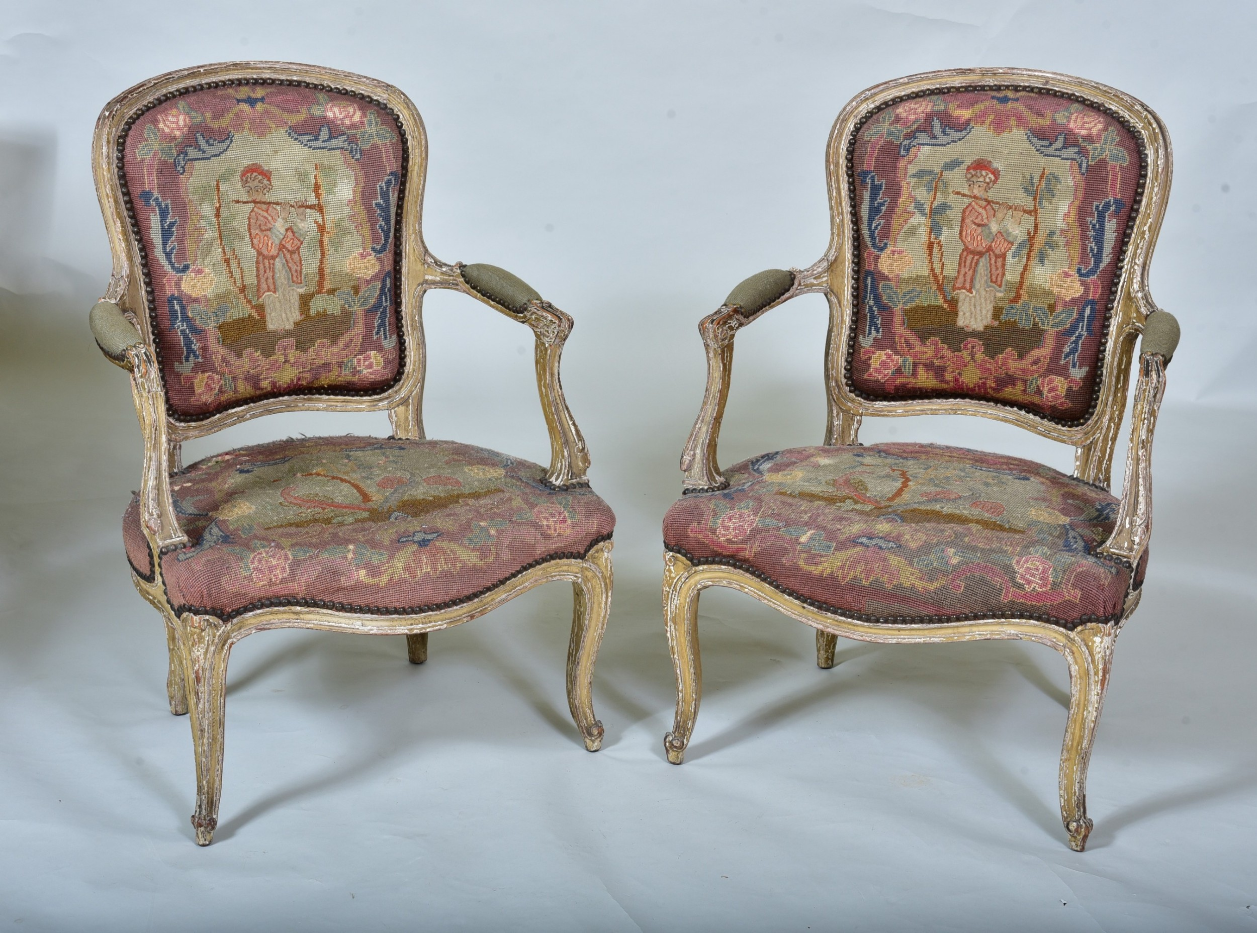 pair of late 18th c french chairs with original paint surface and tapestry backs seats