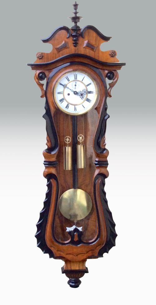 fabulous serpentine shaped antique double weighted vienna black and walnut wall clock