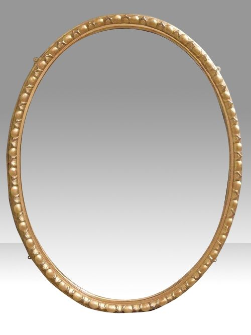 large antique english giltwood oval wall mirror