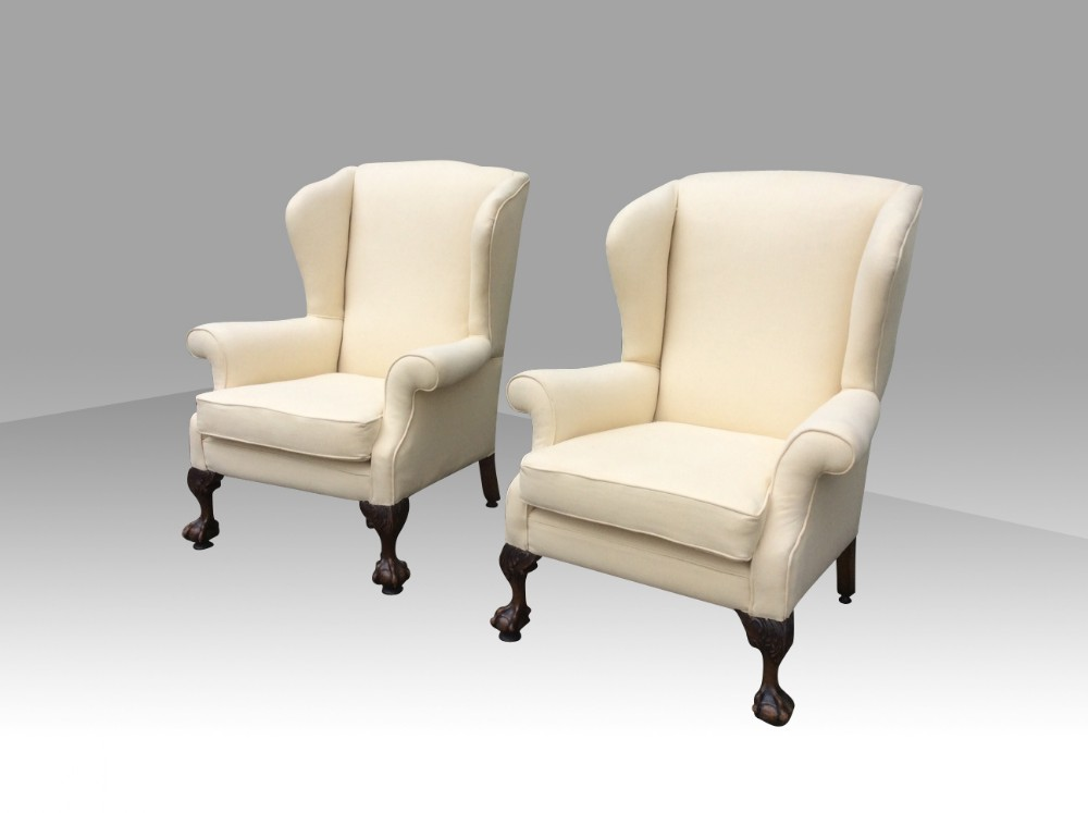 pair of antique wing back wingback armchairs with mahogany ball and claw feet