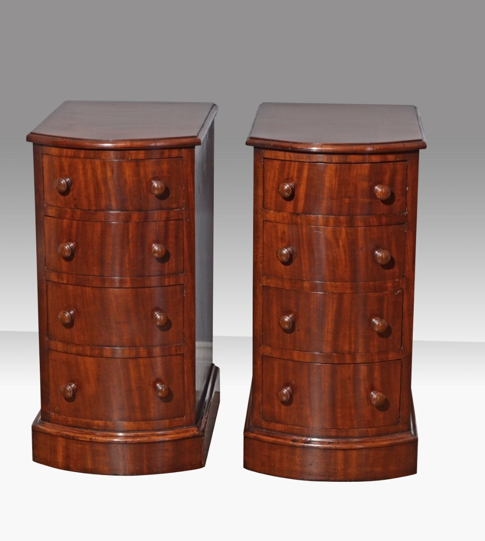 pair of narrow antique victorian bow front mahogany bedside chestscabinets