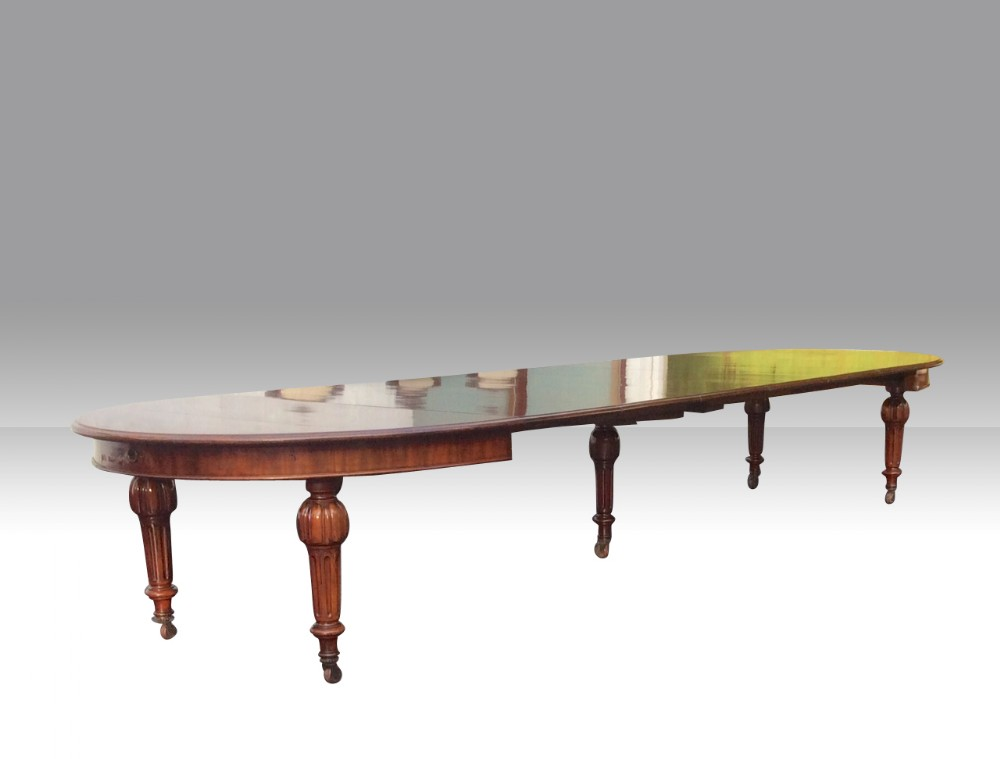 very large antique mahogany extending dining table