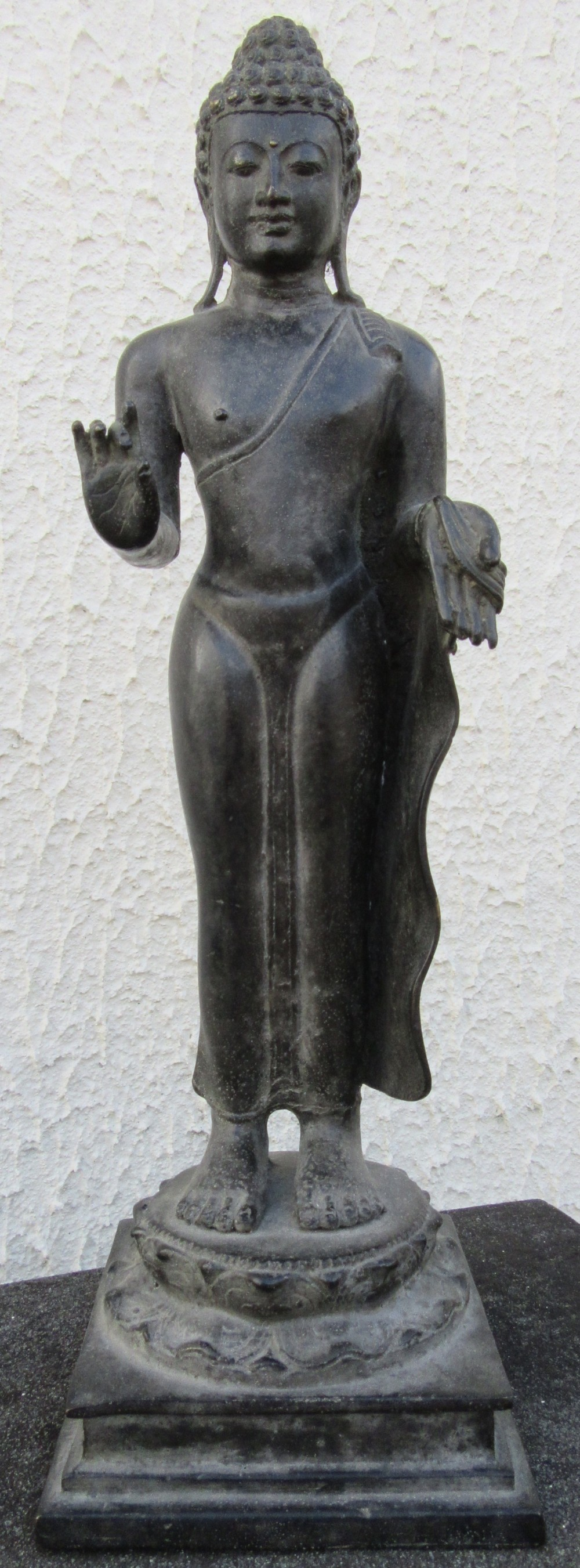 a rare bronze figure of the standing buddha 14th century