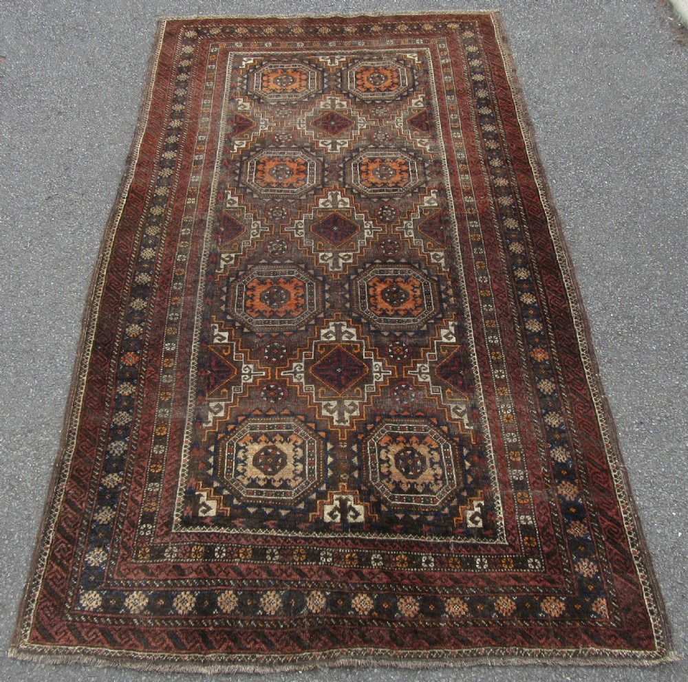antique persian baluch large rug salor khani tribe with turret gul medallions