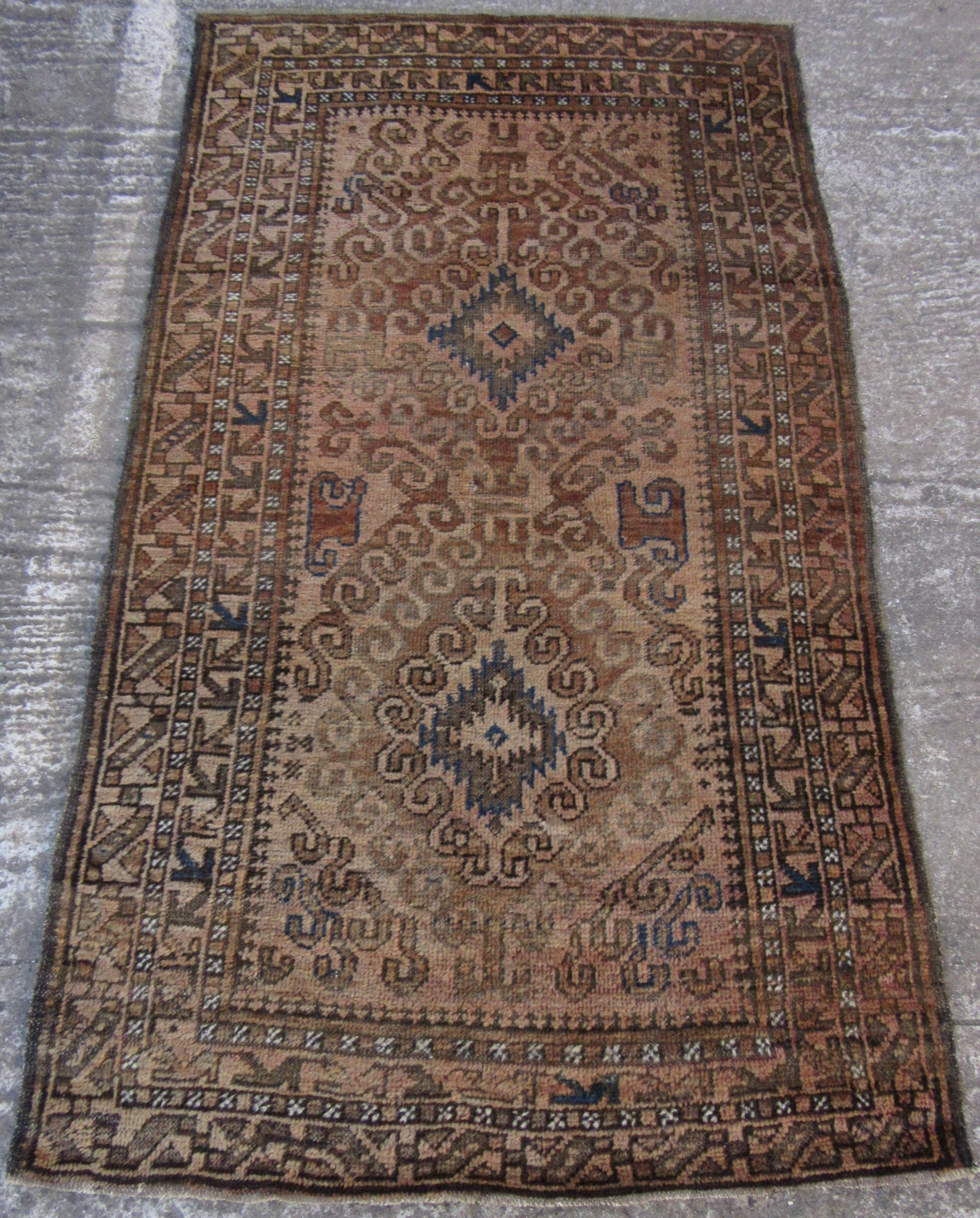 an unassuming antique country house shabby chic persian balouch baluch baluchi tribal rug