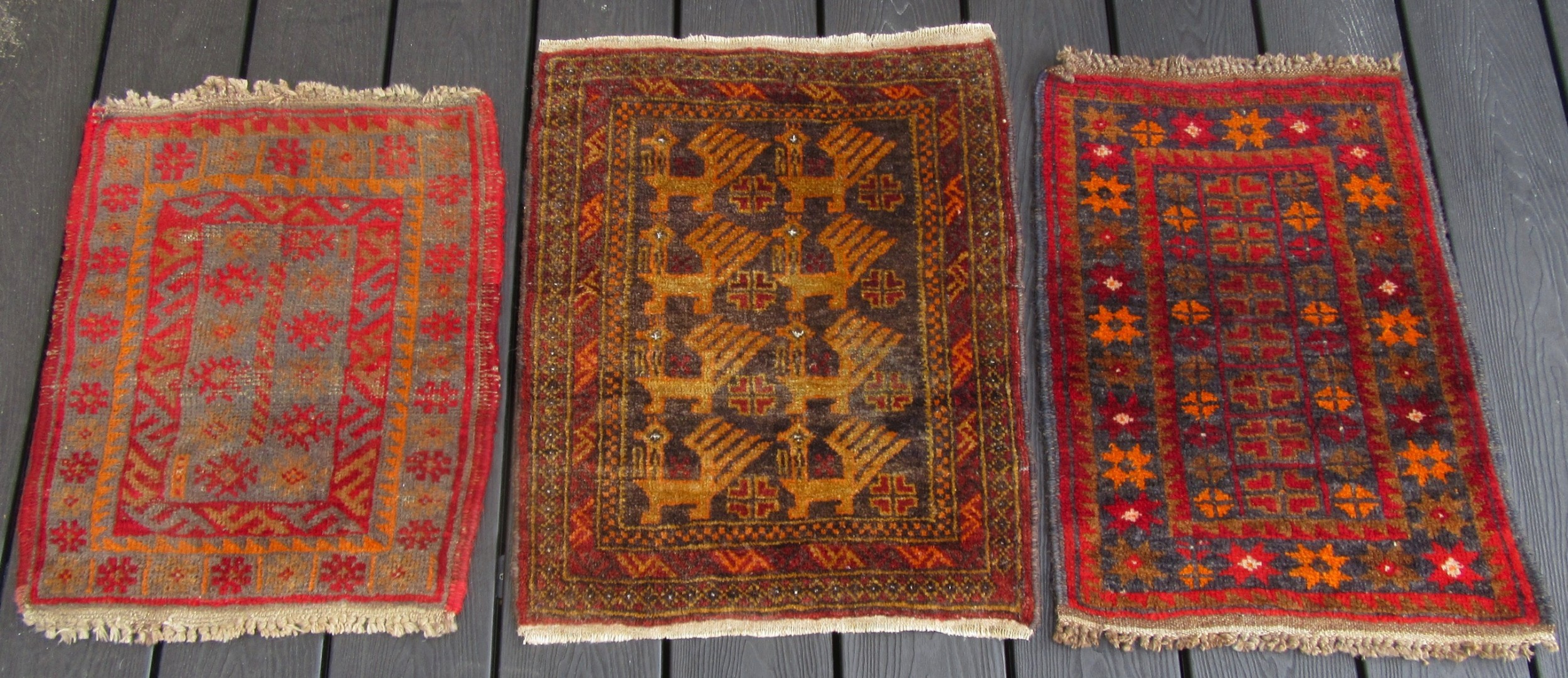 a group of three small old persian baluch scatter rugs great for scattering over larger rug