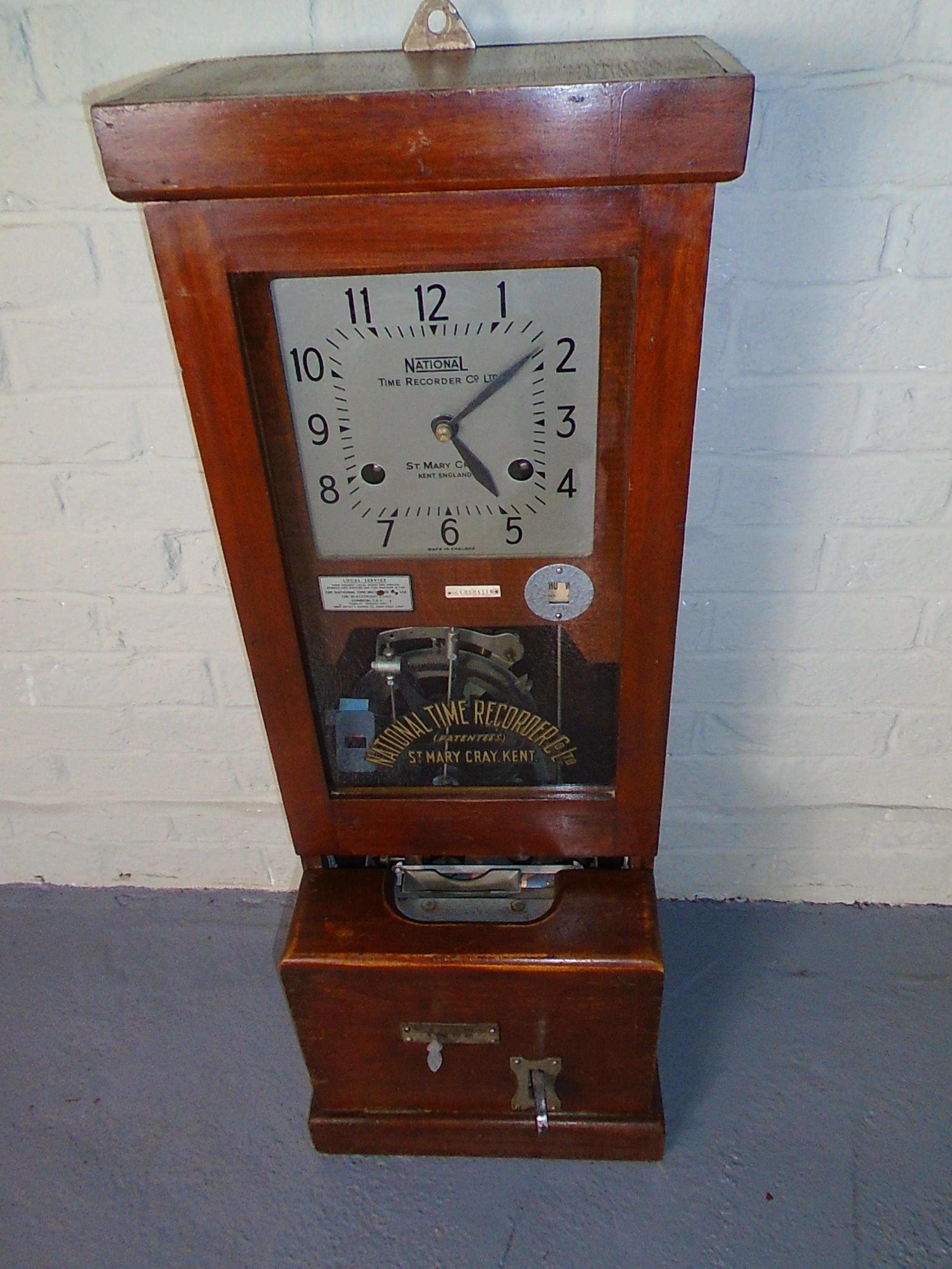 national mahogany cased clocking in wall clock