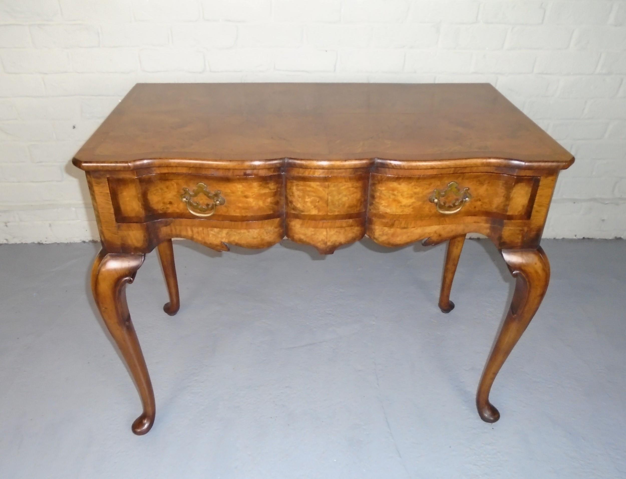 queen anne style burr walnut serpentine dressing table