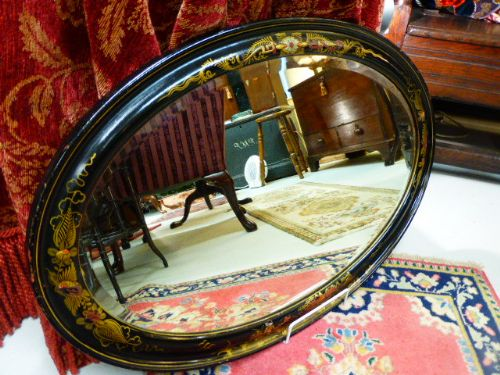 late 19th c black lacquered oval mirror