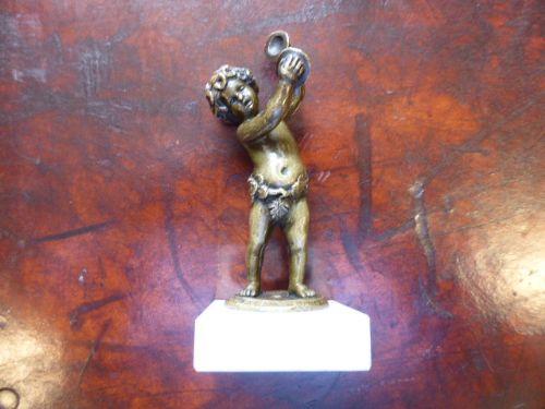 small bronze putti desk ornament