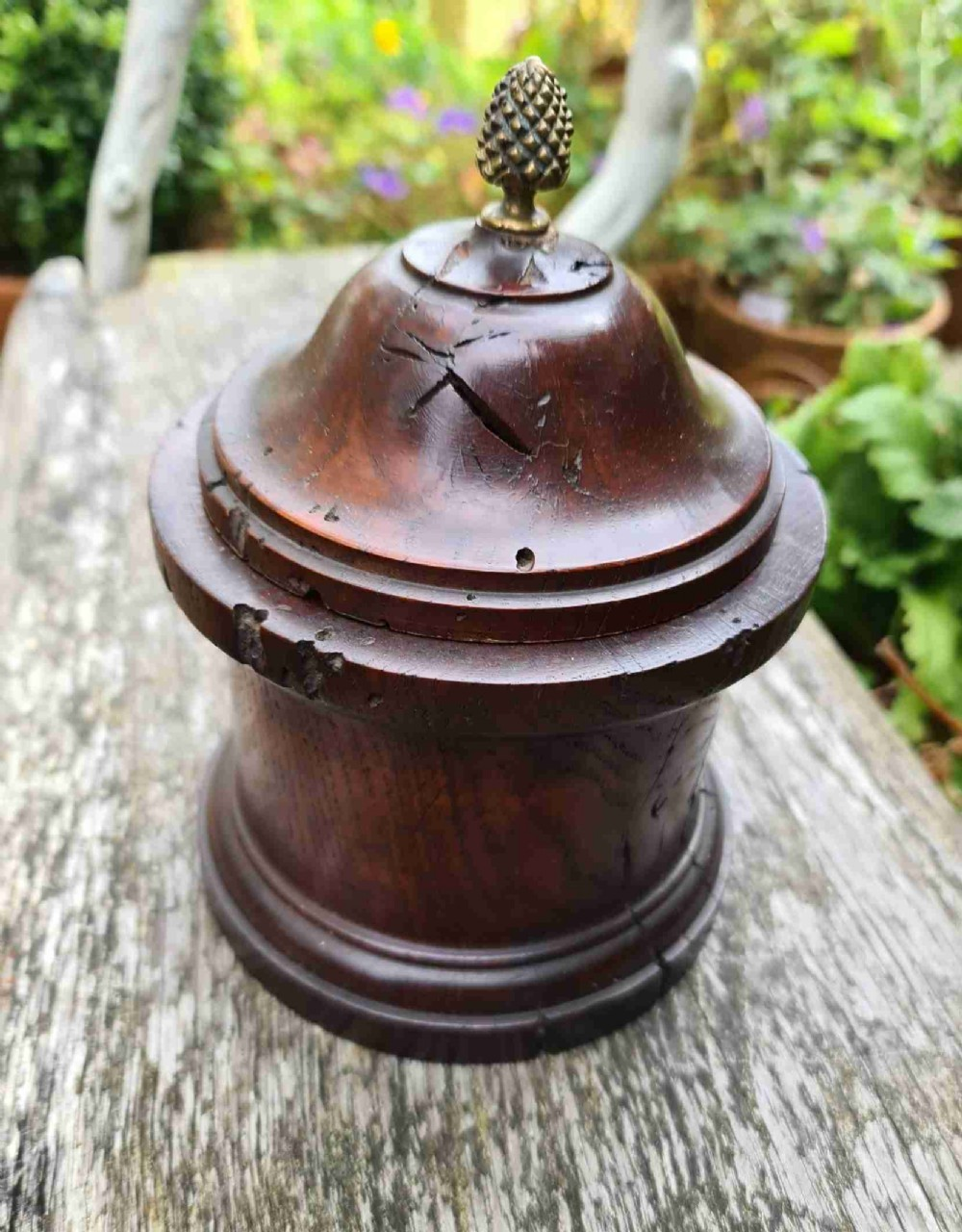 small round oak jar with brass finial 18th century