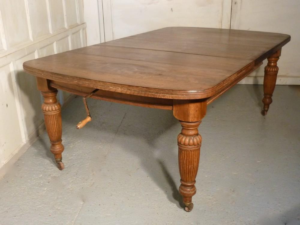arts and crafts golden oak wind out table extending dining. Black Bedroom Furniture Sets. Home Design Ideas