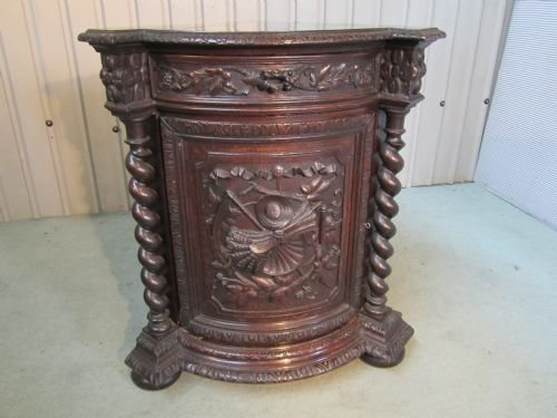 carved gothic oak corner cupboard