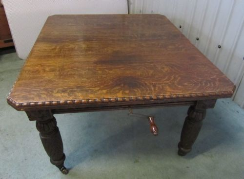 A Superbly Carved Victorian Oak Wind Out Extending Gothic Oak Dining Table