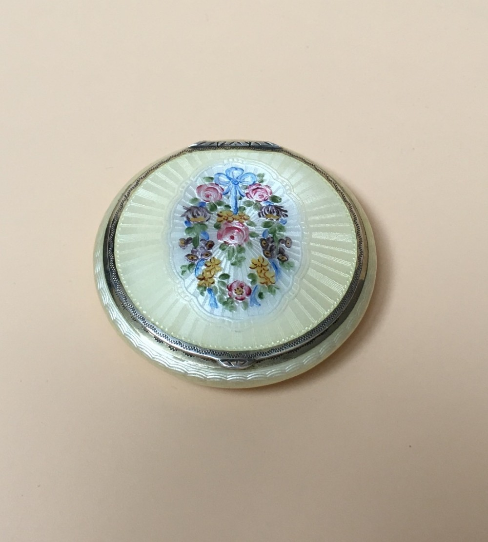 sterling silver guilloche enamel compact case with a garland of flowers