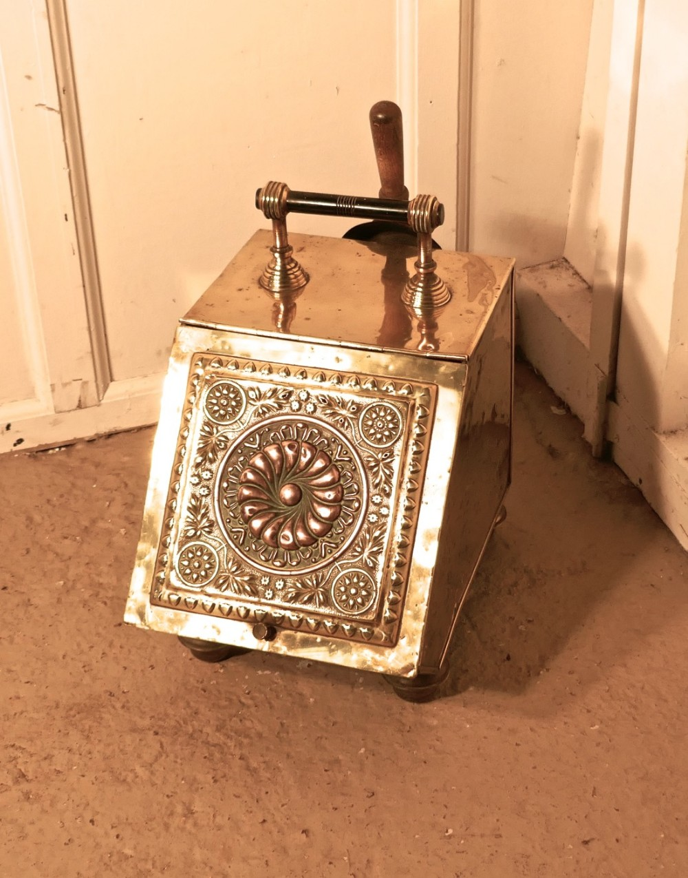a victorian brass coal scuttle with liner and shovel