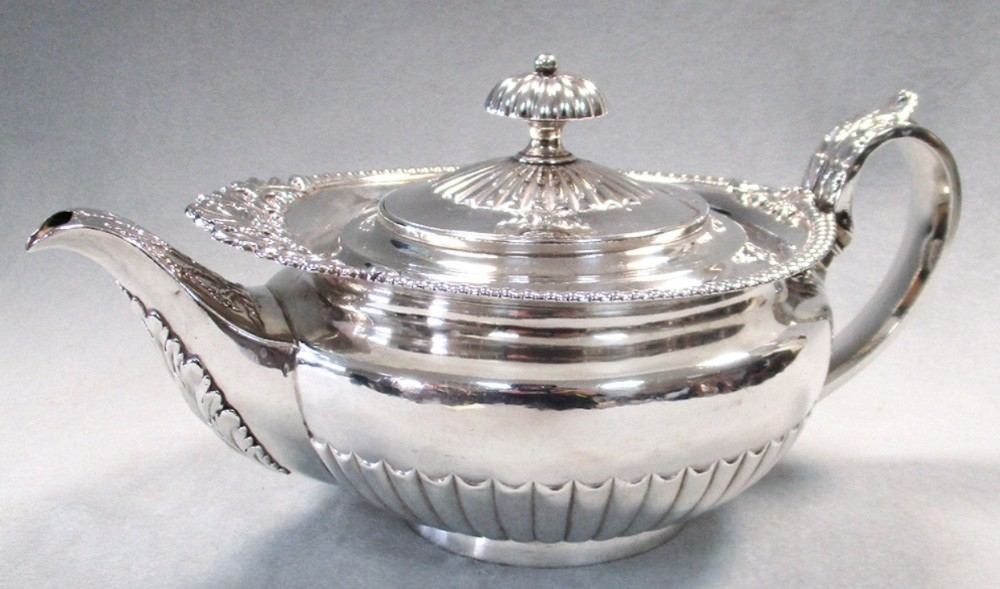 a large george iv silver teapot by william eley ii london 1823