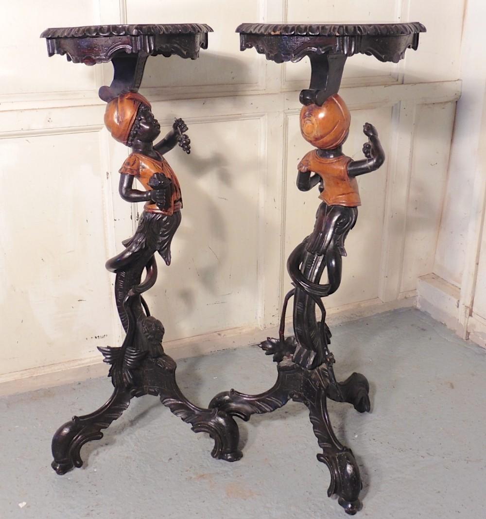 a pair of venetian blackamoor wine tables
