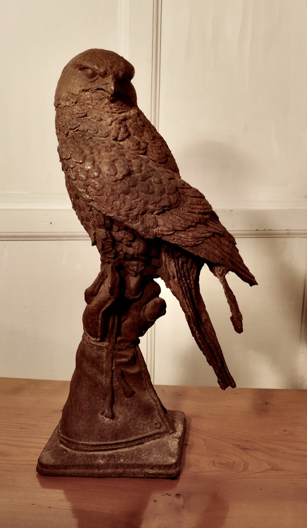 2ft tall cast iron statue of a falcon on a gloved hand