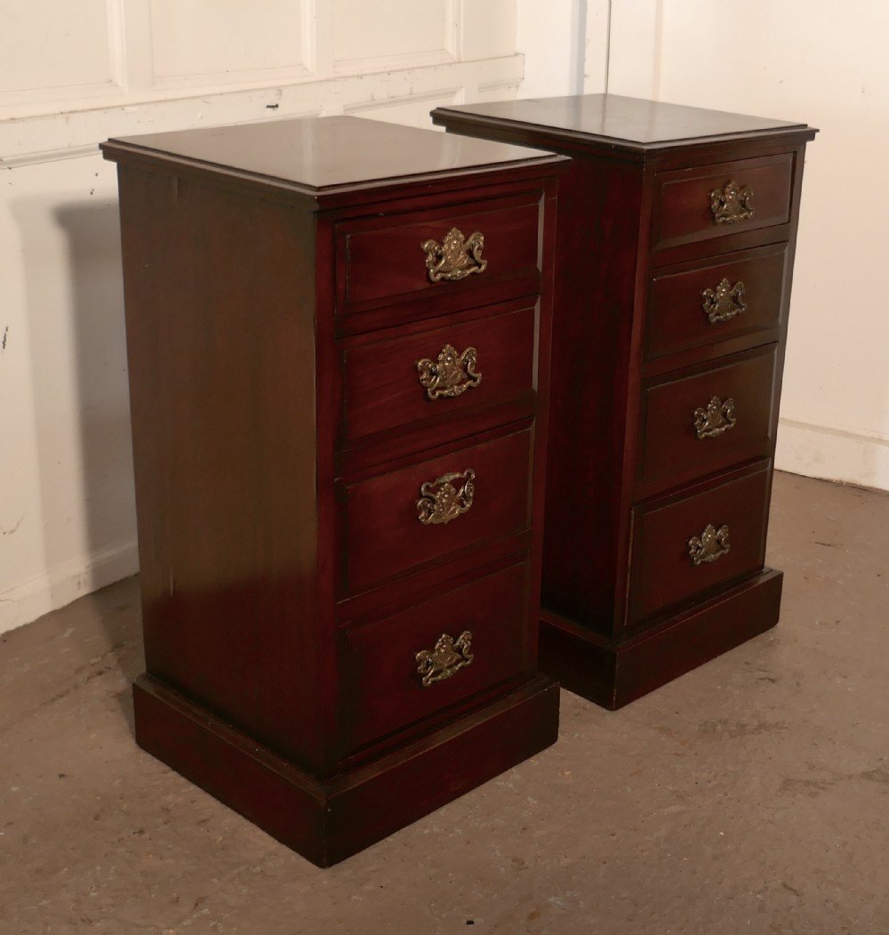 a pair of georgian style mahogany bedside chest of drawers