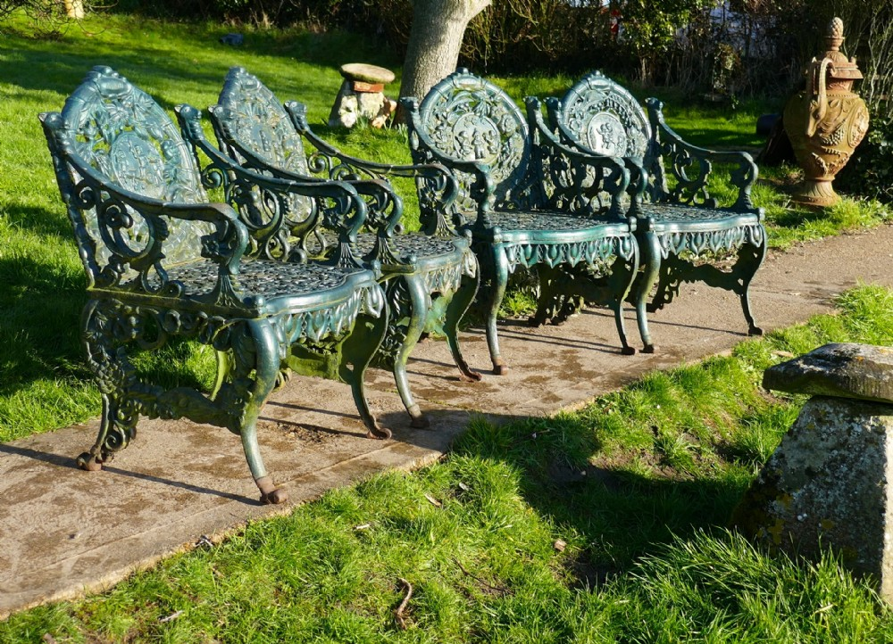 set of 4 cast iron garden arm chairs 4 seasons plaques on the backs