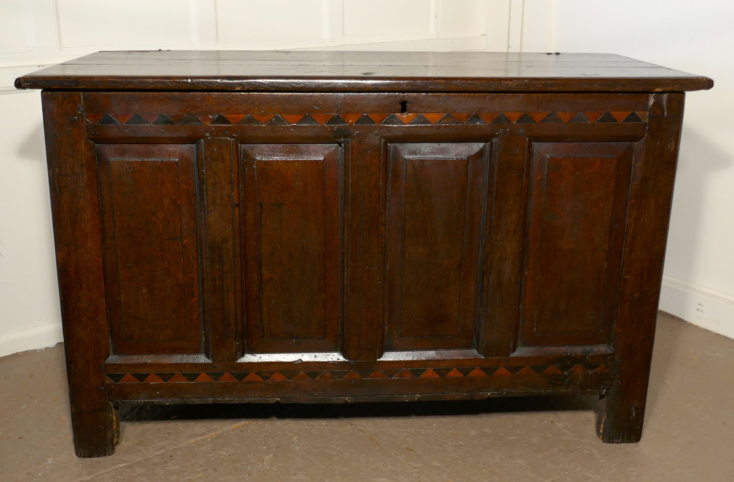 a large 17th century inlaid panelled oak coffer