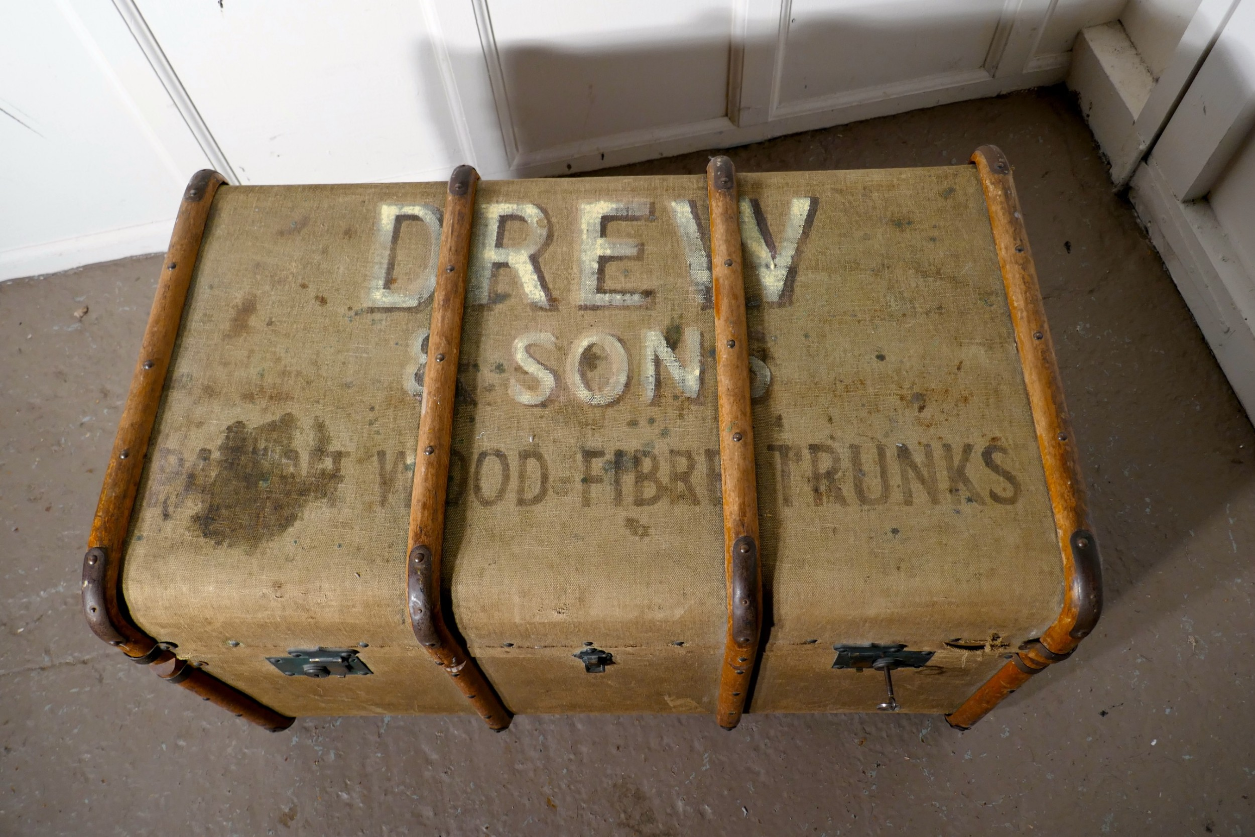 a large vintage drew and sons canvas steamer trunk