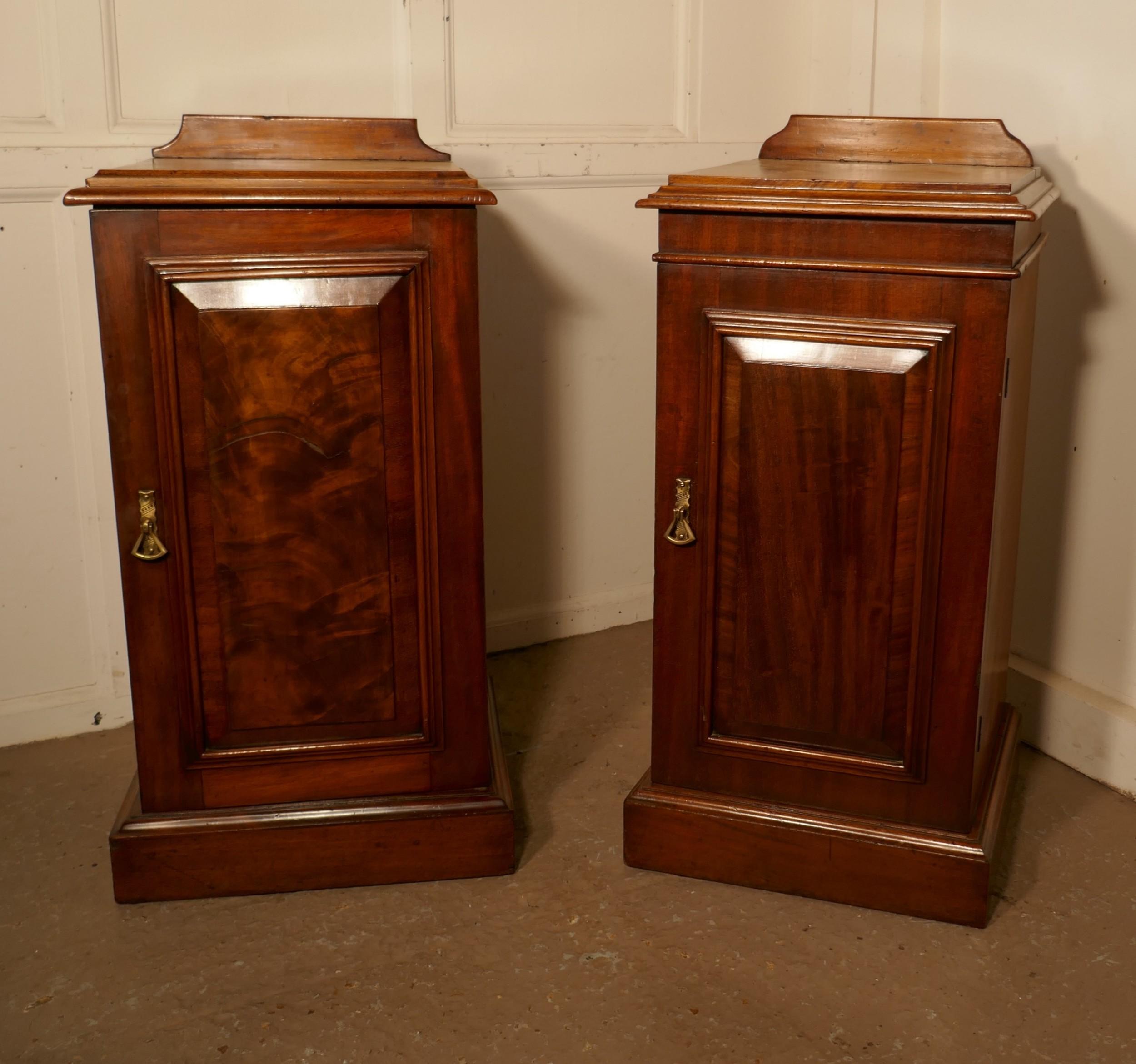 a near pair of victorian walnut bedside cupboards