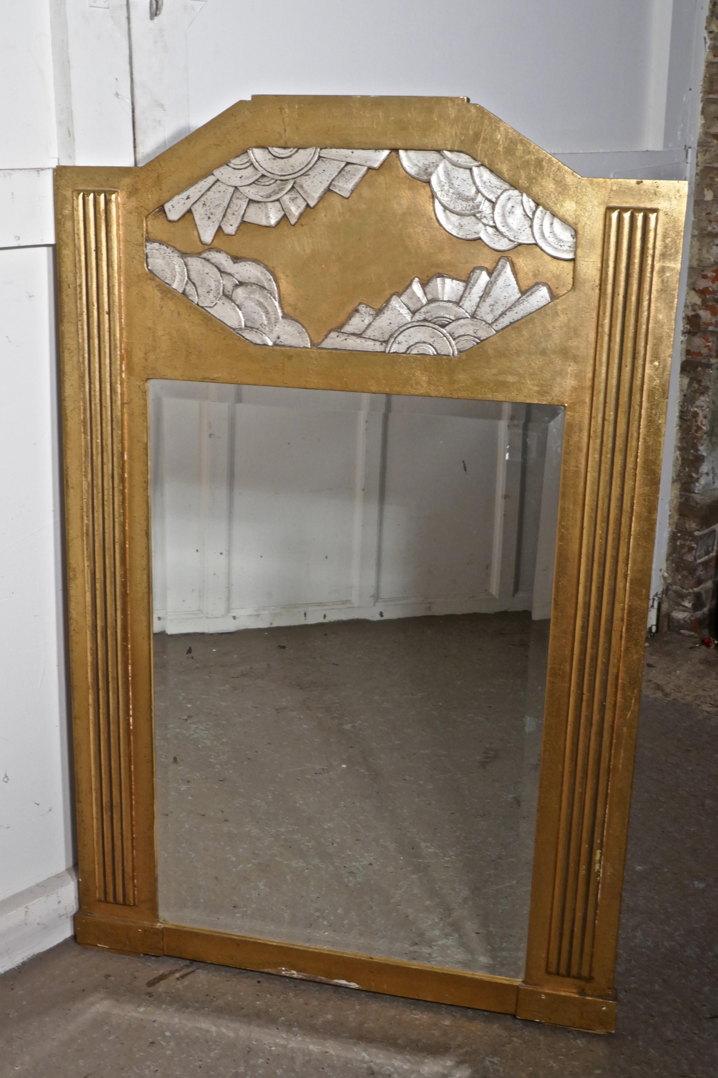 a large french odeon style art deco gilt wall mirror