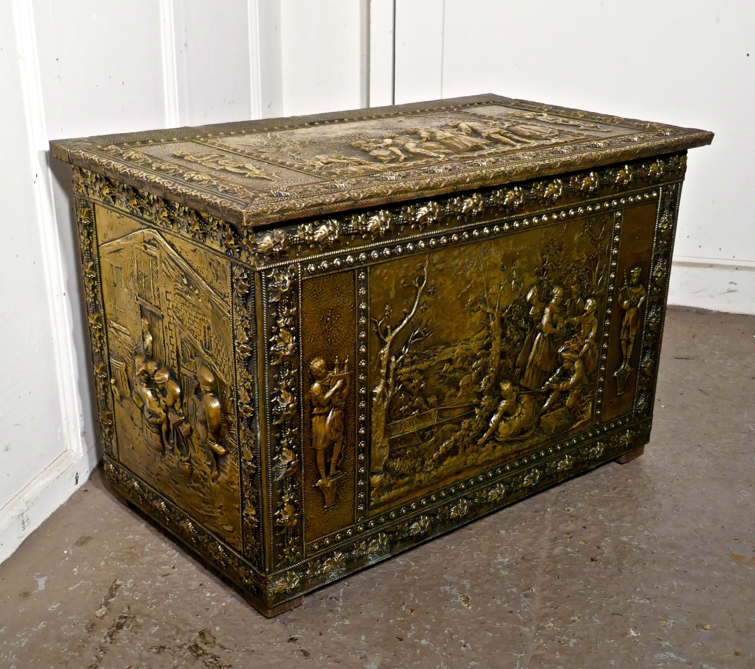 very large french embossed brass log box with country scenes