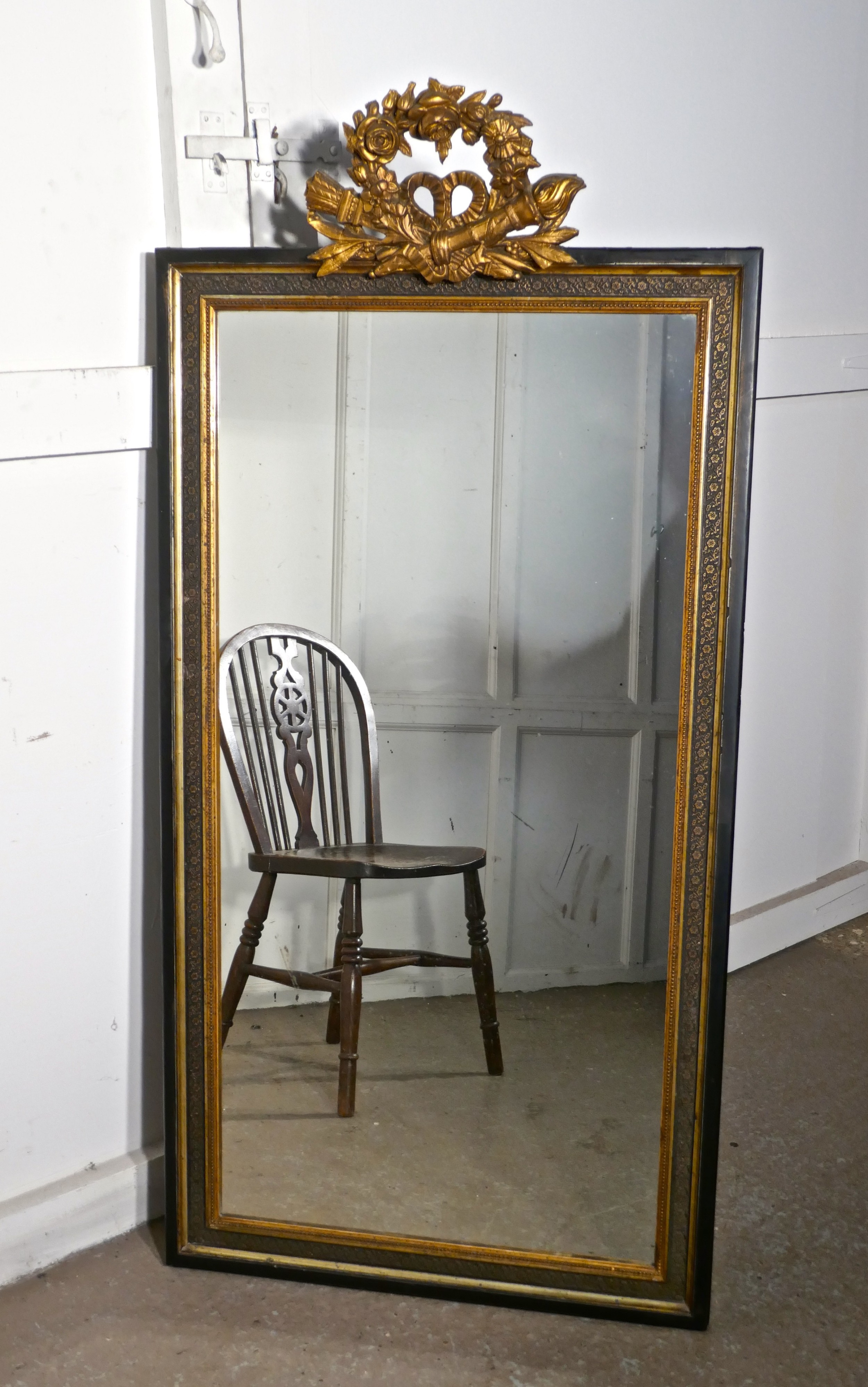 large french ebonised and gilt wall mirror torch and quiver crest