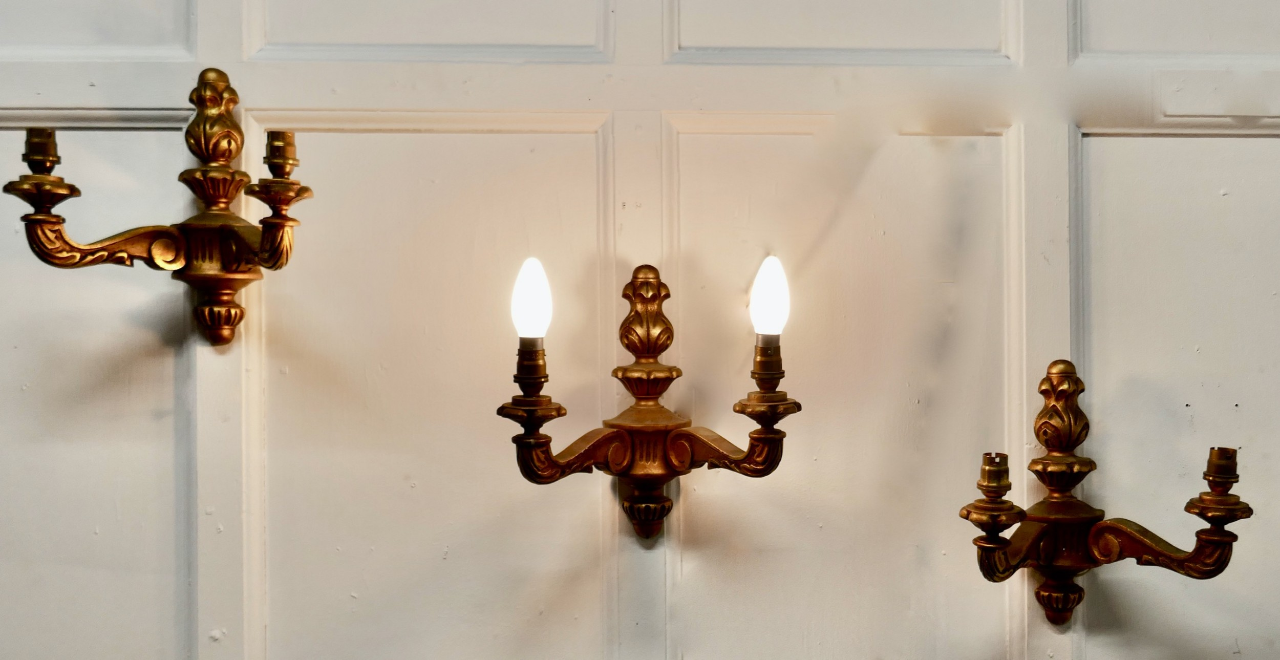 a set of 3 gilt wood carved twinwall lights